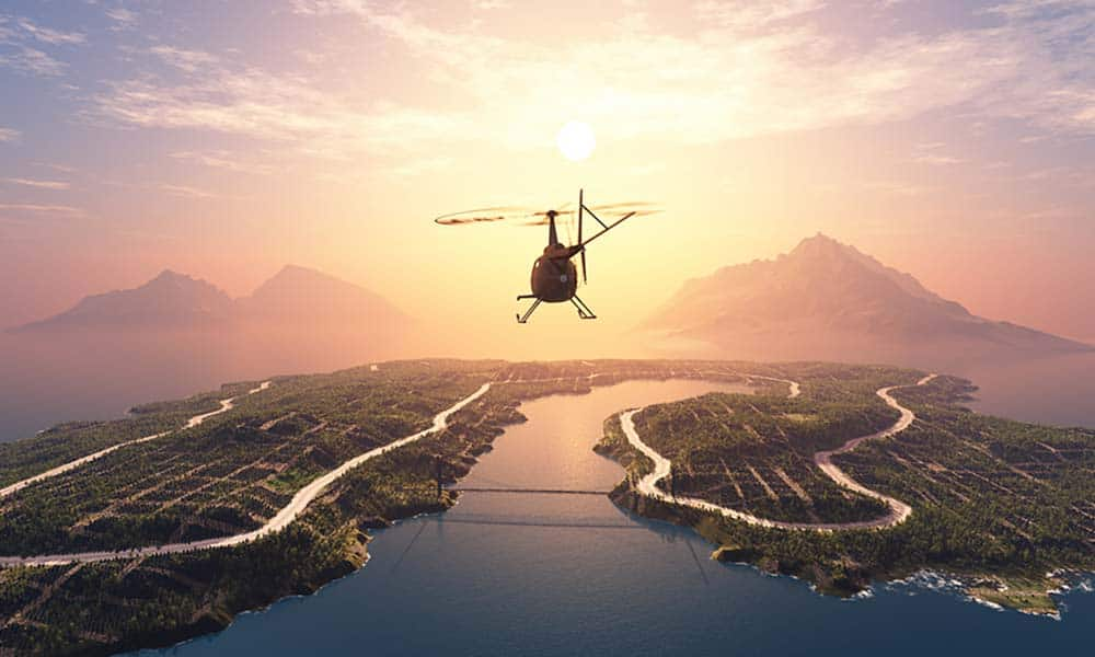 image of helicopter flying into sunset