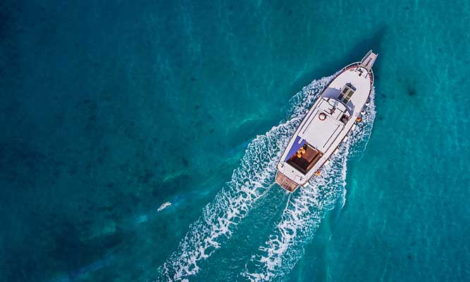 birds eye view of a boat in the coral sea
