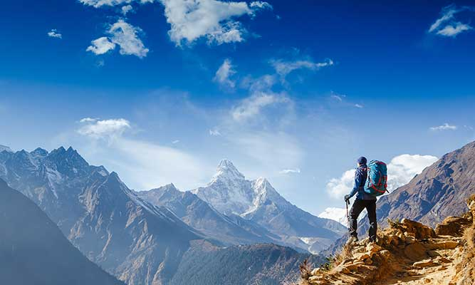 hiker achieving life goals in the Himalayas