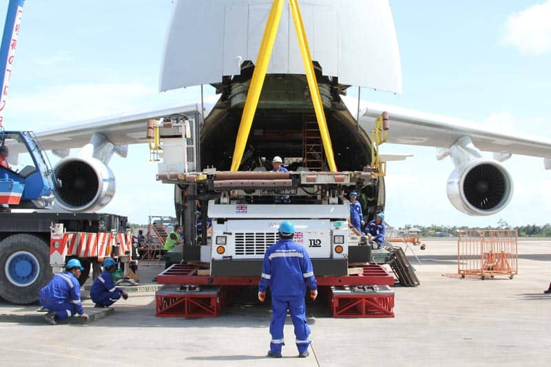 image of men loading items into the back of an airplane