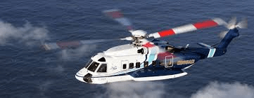image of a helicopter flying over a stretch of water