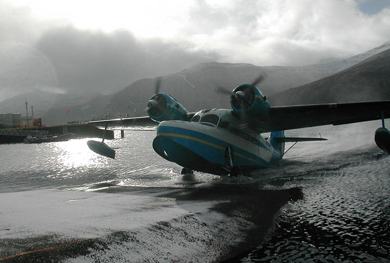 image of a two engine airplane with propellers in water