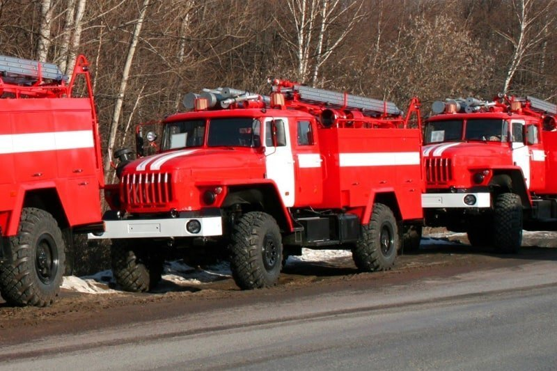 image of three large red trucks used for emergency situations