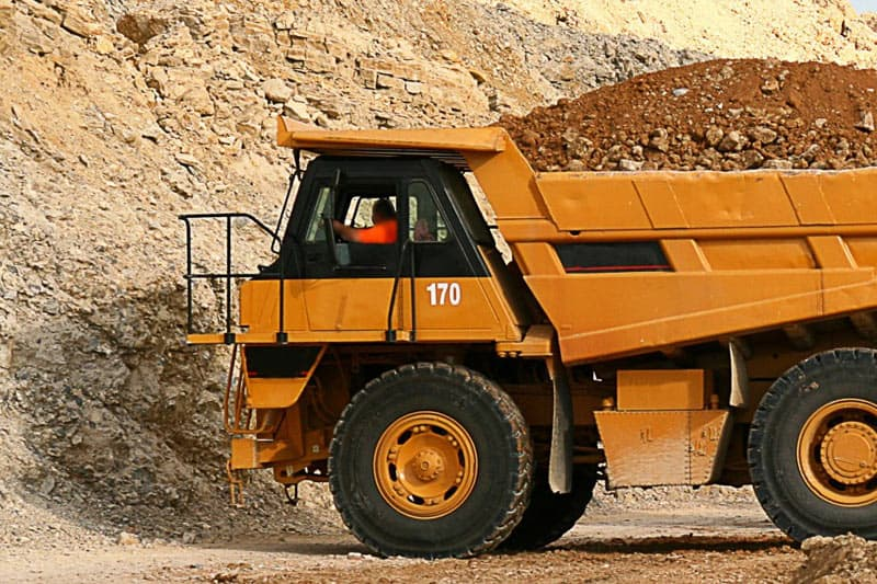 image of a large yellow truck used for hauling dirt