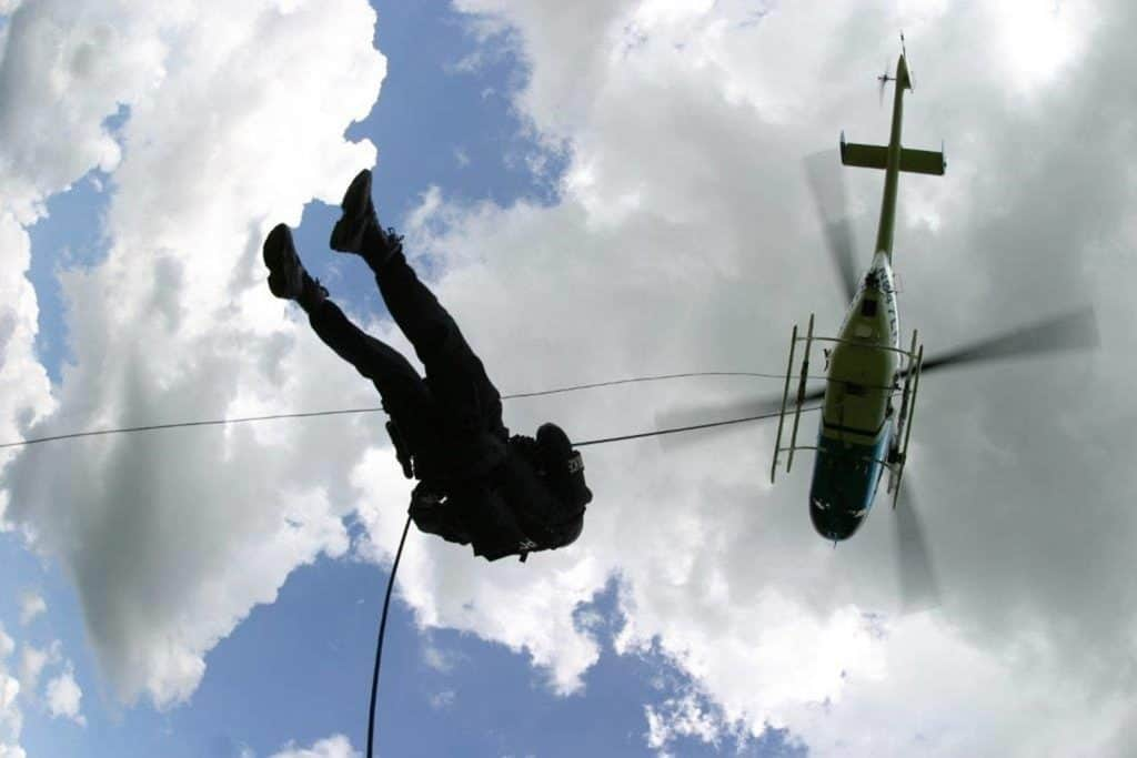 law enforcement officer jumps from helicopter