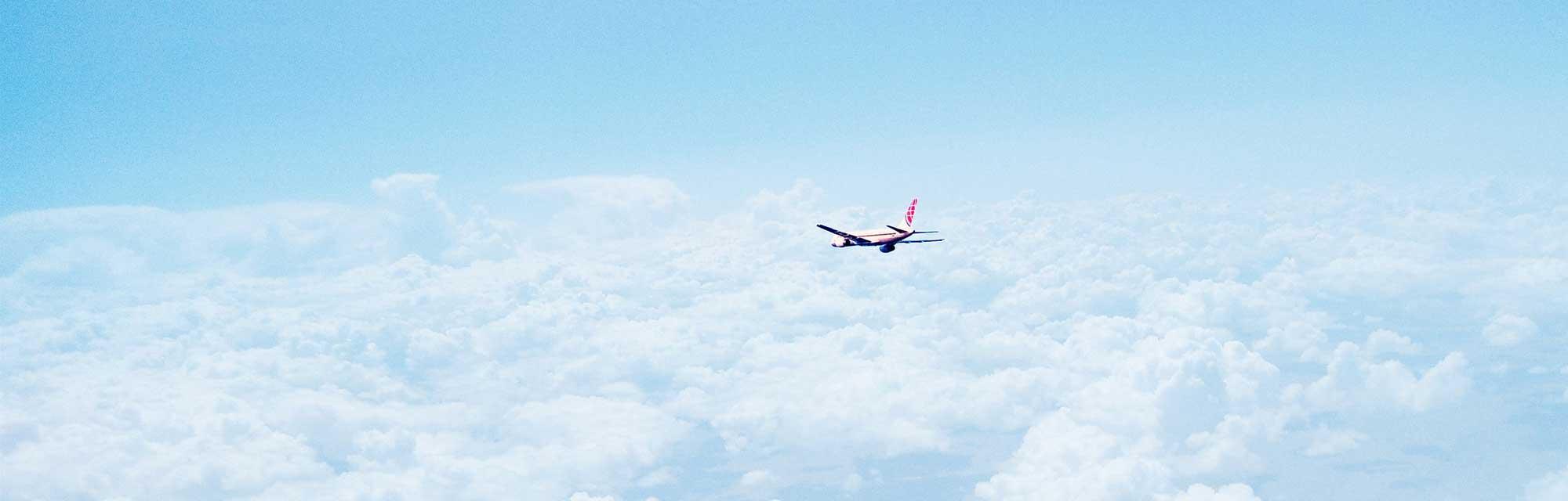 airplane flying in blue sky