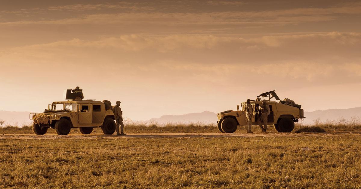 Military soldiers using satellite communications equipment